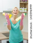 Happy housewife cleaning in the kitchen. - stock photo