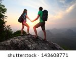 young couple relaxing on top of ... | Shutterstock . vector #143608771