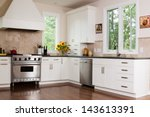 Stock photo upscale kitchen in a modern home 143613391