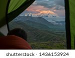 Person Looking From A Tent At...