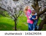 family walk in the spring garden | Shutterstock . vector #143629054