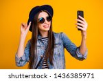 Small photo of Close-up portrait of her she nice-looking charming attractive lovely winsome fascinating cheerful cheery straight-haired lady making taking selfie isolated over bright vivid shine yellow background