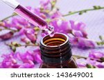 closeup of a dropper bottle and ... | Shutterstock . vector #143649001