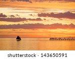 Boat Sailing While The Sun Set  ...