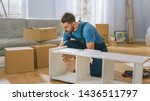 Professional Furniture Assembly Worker Assembles Shelf. Professional Handyman Doing Assembly Job Well, Helping People who Move into New House. - stock photo
