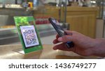 Stock photo qr code cashless payment scan to pay system business or technology concept young man using 1436749277