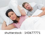 woman covering ears with pillow ... | Shutterstock . vector #143677771