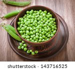 Green Peas In A Ceramic Bowl O...