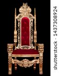 Red royal chair isolated on black background. Place for the king. Throne. Tsar