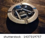 Small photo of astray with leftover cigarettes inside