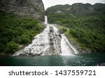Geirangerfjord seen from the sea safari ride. Bridal veil waterfall (also known as  Brudesloret) with a height of approximately 300 meters. Norway, Scandinavia. - stock photo