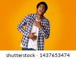 teenage guy laughing out loud ... | Shutterstock . vector #1437653474