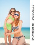 beautiful mother and little... | Shutterstock . vector #143800117