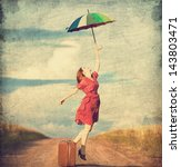 redhead girl with umbrella and... | Shutterstock . vector #143803471