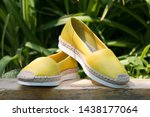Stock photo a pair of yellow espadrilles on a green background espadrilles on a background of green grass 1438177064
