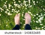 Female Feet Standing On Green...