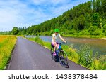 Young Woman Riding Bike On...