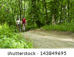 two girls riding the bicycle in ... | Shutterstock . vector #143849695