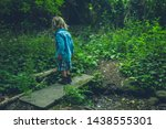 a little toddler is walking in... | Shutterstock . vector #1438555301