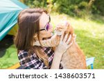 Stock photo people tourism and nature concept woman in sunglasses holding a cat sitting near the tent 1438603571
