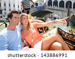couple on a gondola ride... | Shutterstock . vector #143886991