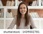 smiling caucasian girl look at...   Shutterstock . vector #1439002781