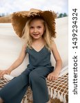 Little cute girl in stylish...