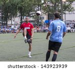 NEW YORK - JUNE 26: Marco Bellinelli and Oguchi Onyewu play at The Sixth Steve Nash Foundation Showdown at Sarah D. Roosevelt Park on June 26, 2013 in New York City. - stock photo
