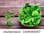 fresh baby spinach leaves in a... | Shutterstock . vector #1439345057