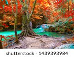 waterfall in autumn with tree...   Shutterstock . vector #1439393984