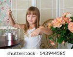 beautiful little girl sitting... | Shutterstock . vector #143944585