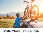 mountain biker man take of his... | Shutterstock . vector #1439473937