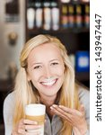 Smiling Blond Woman With Milk...