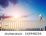 White Fence With Bird House An...