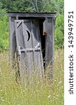 An Old Outhouse With Door...
