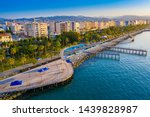 Limassol. Cyprus. The seafront of Limassol Molos day panorama. Beach promenade Limassol from the height. Mediterranean sea coastline. The beaches of Cyprus. Vacation in Cyprus seaside.
