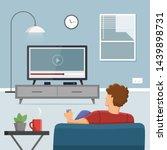 man watching tv in living room | Shutterstock .eps vector #1439898731