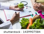 nutritionist giving... | Shutterstock . vector #1439907584