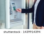 Business Man Using Atm. Person...