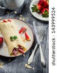 strawberry pancakes with... | Shutterstock . vector #143999524