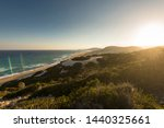 beautiful sunset at the beach.... | Shutterstock . vector #1440325661