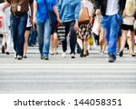 motion blurred pedestrians... | Shutterstock . vector #144058351