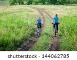 women relax biking outdoors | Shutterstock . vector #144062785