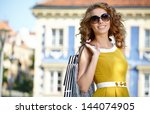 shopping woman in city | Shutterstock . vector #144074905