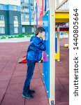 teenager plays hide and seek... | Shutterstock . vector #1440805664