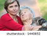 senior woman and her daughter... | Shutterstock . vector #1440852