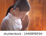 Religious Asian Buddhist Woman...