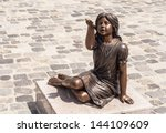 Statue Of A Little Girl In The...