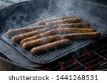 cooking sausages on the... | Shutterstock . vector #1441268531