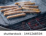 cooking sausages on the... | Shutterstock . vector #1441268534